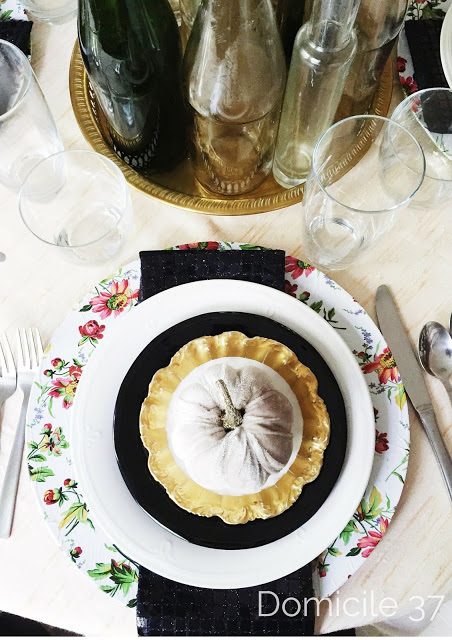 An eclectic vintage inspired Fall table setting perfect for a dinner party.