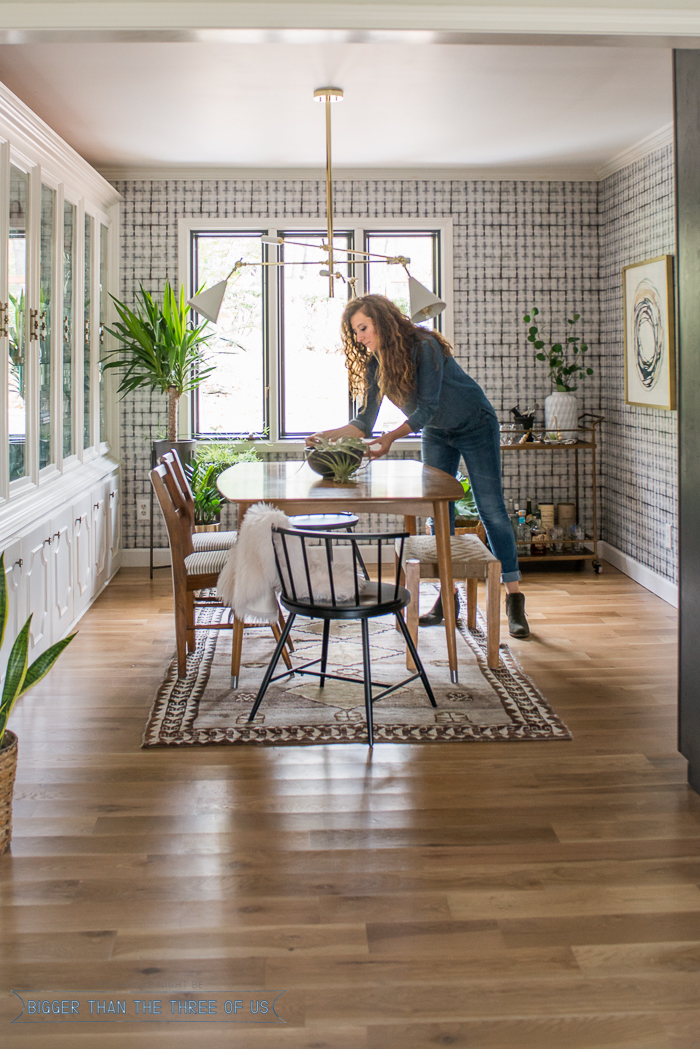 bigger-than-the-three-of-us-eclectic-class-dining-room-with-shibori-wallpaper-mid-century-table-and-vintage-rug-3