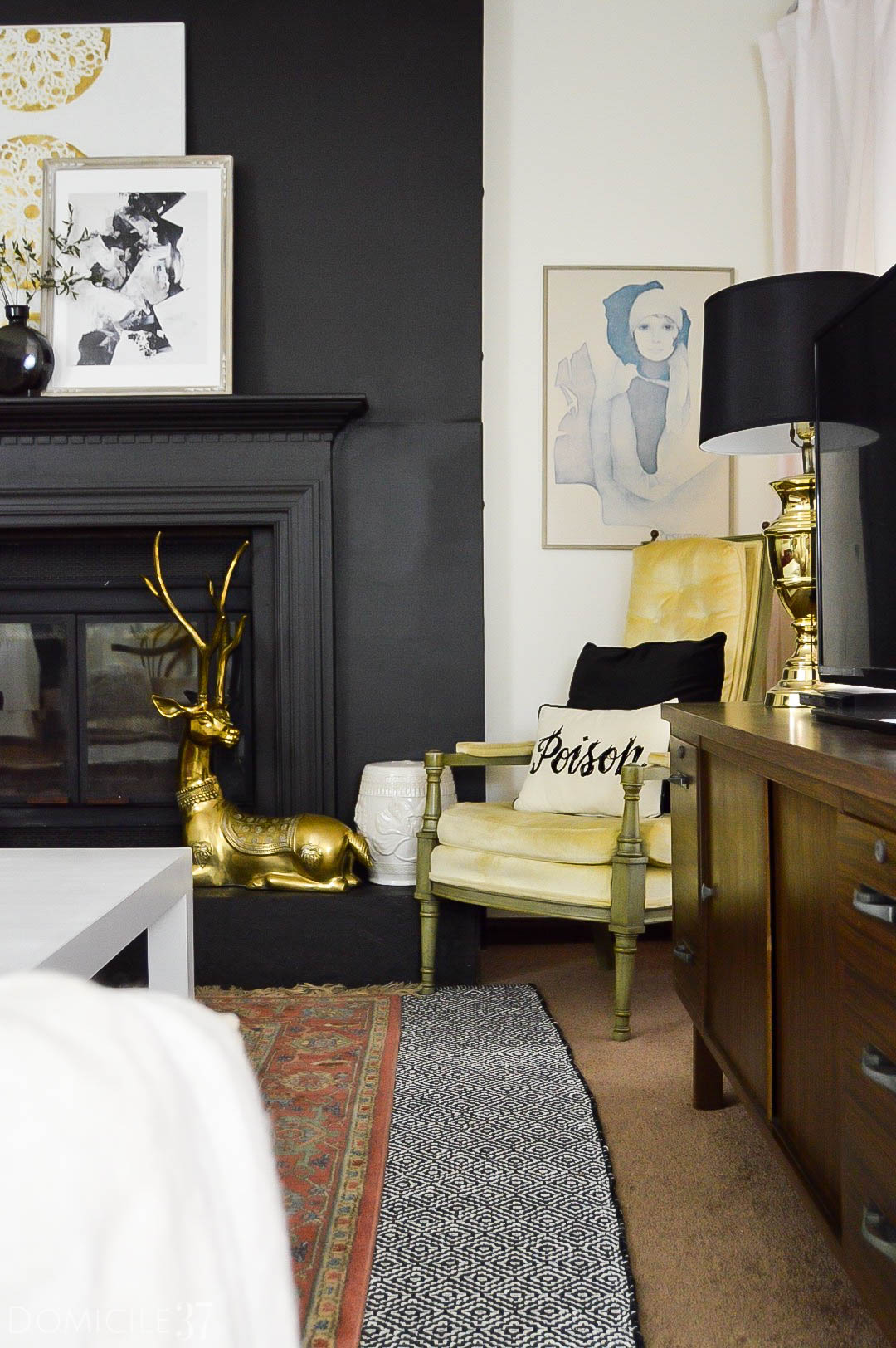 Faux Fireplace | Rental Friendly Fireplace | Black Fireplace | Stone Fireplace coverup | Chic fireplace | Eclectic living room