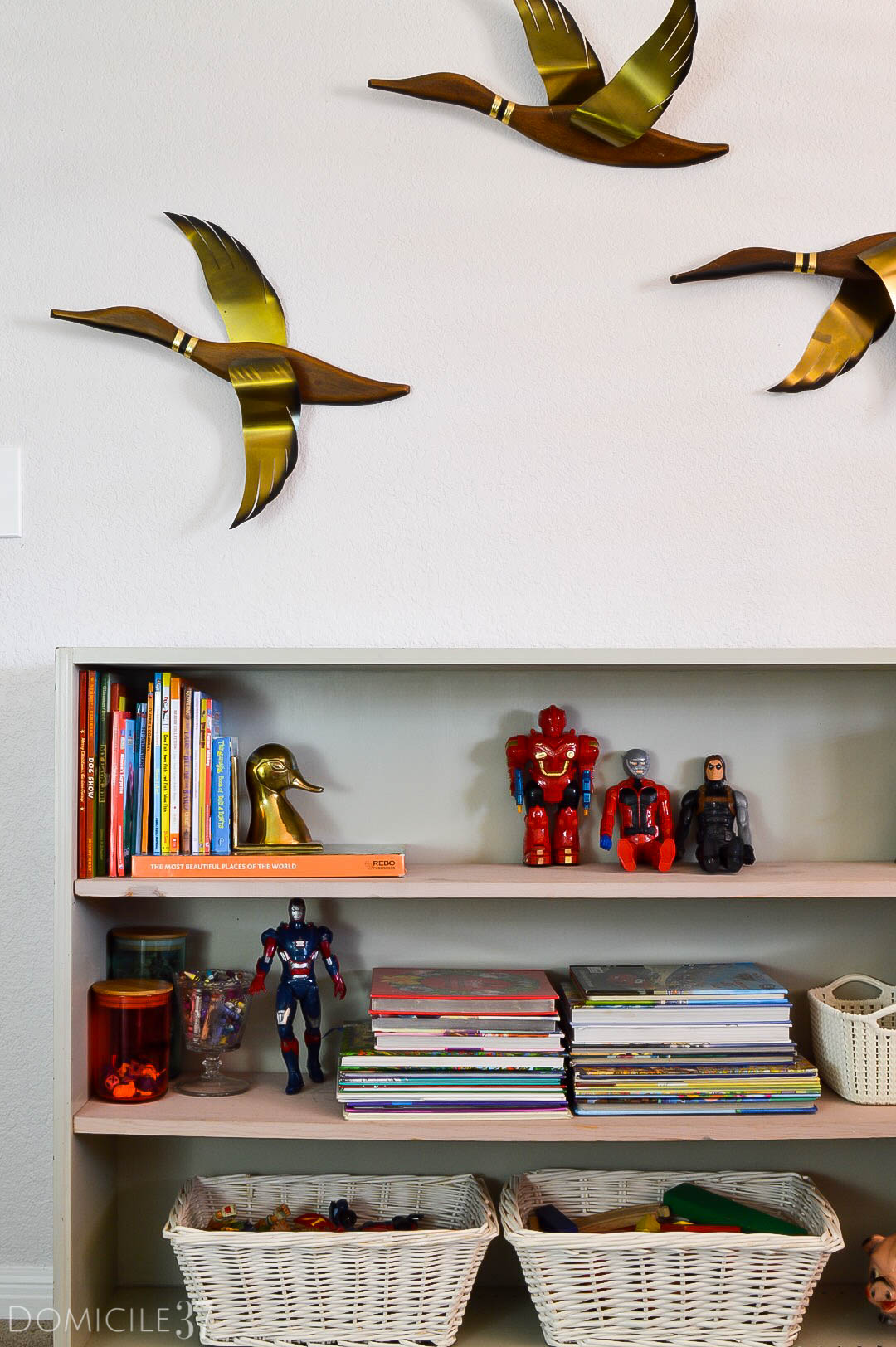 Vintage Eclectic little boy's room | Wes Anderson inspired bedroom | colorful boy's room | collected bedroom | eclectic bedroom ideas | vintage bedroom ideas | colorful bedroom ideas | kids bookshelf idea | shelf styling for boy's room | vintage ducks