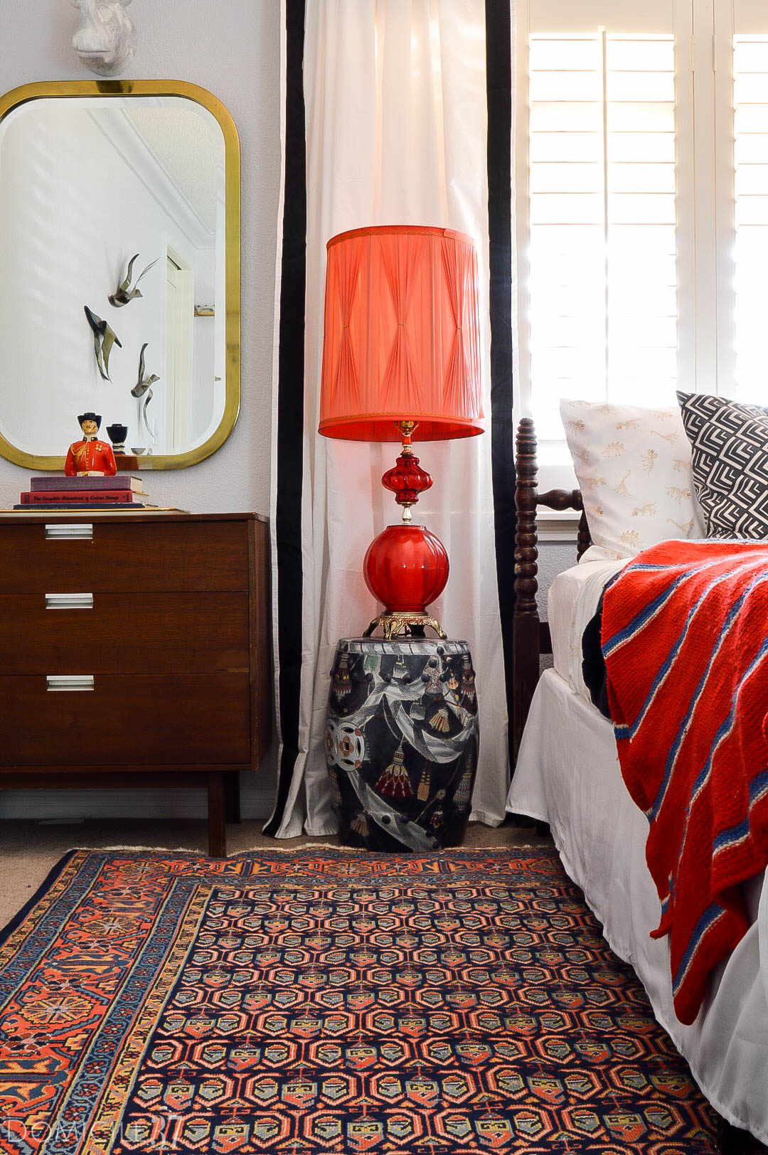 Vintage Eclectic little boy's room | Wes Anderson inspired bedroom | colorful boy's room | collected bedroom | eclectic bedroom ideas | vintage bedroom ideas | colorful bedroom ideas | colorful garden stool | vintage lamps | MCM and Chinoiserie decor