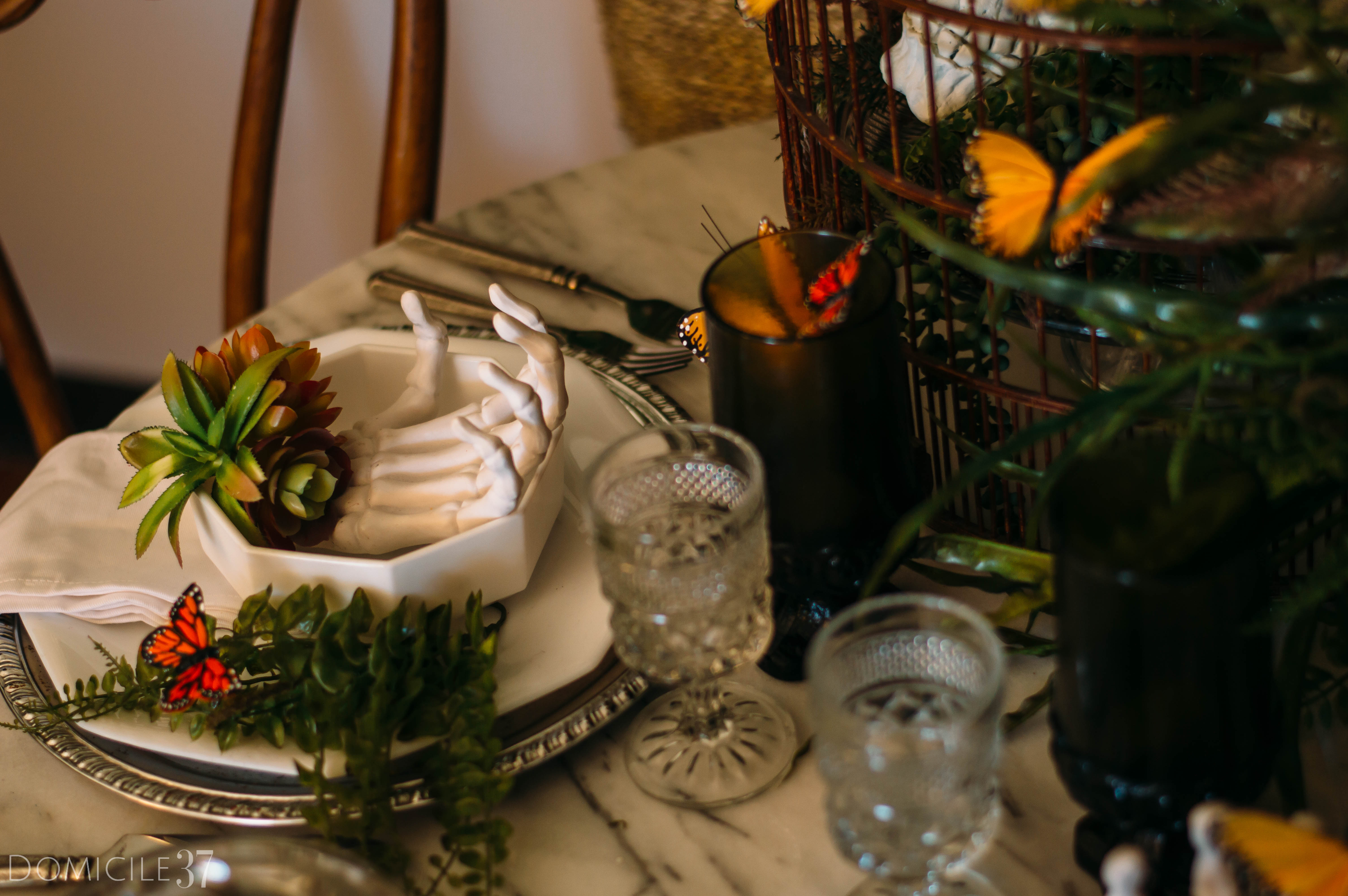 Spooky Creepy Halloween Tablescape | Decorating with Butterflies | Skeleton and skull decor | skulls and butterflies | White dishes | Mix and Match Tablescape | Tablescape Ideas