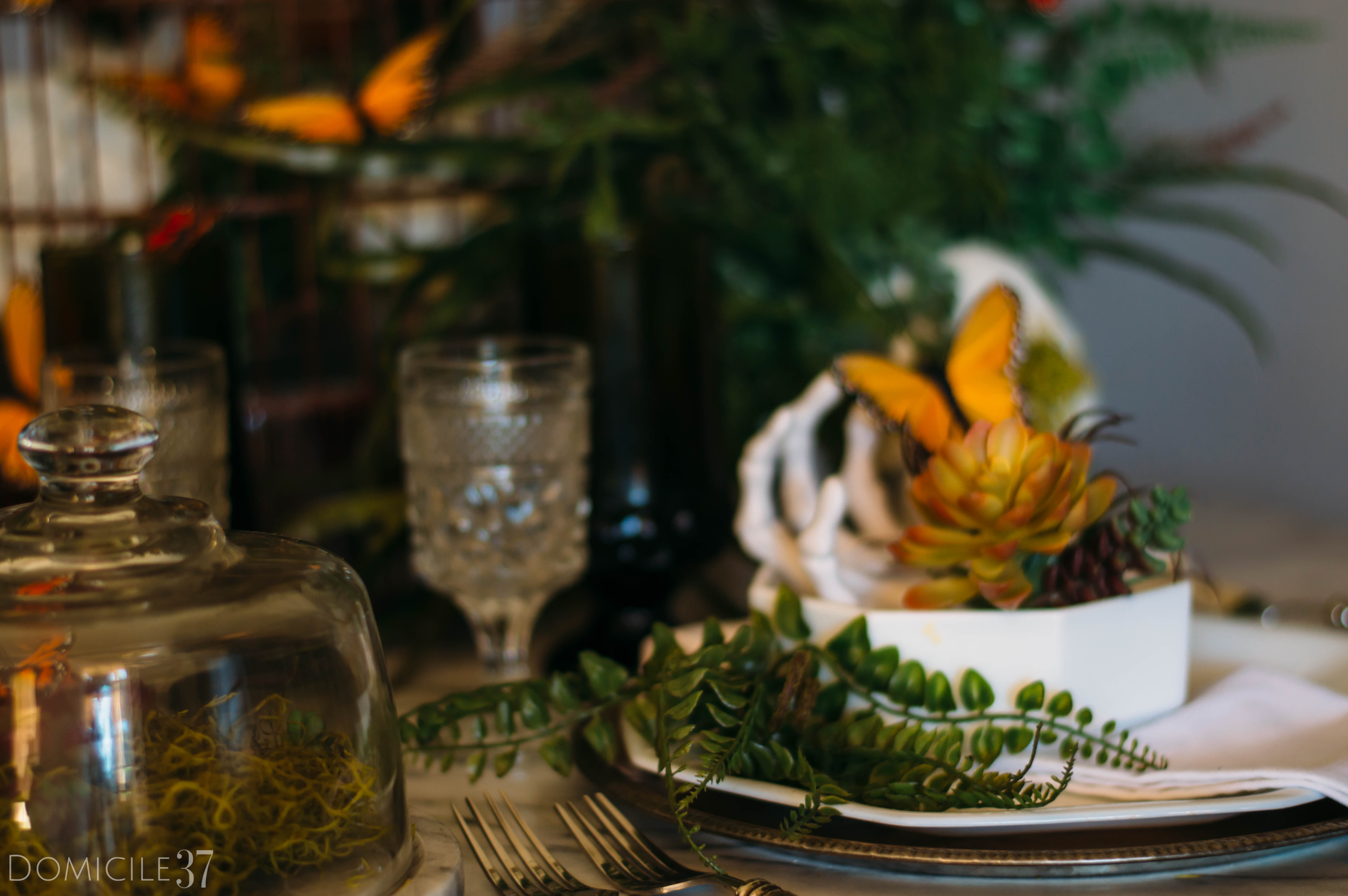 Spooky Creepy Halloween Tablescape | Decorating with Butterflies | Skeleton and skull decor | skulls and butterflies | Tablescape greenery | faux florals