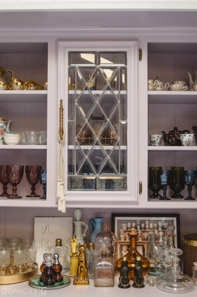 Bar area styled with glassware and decanters
