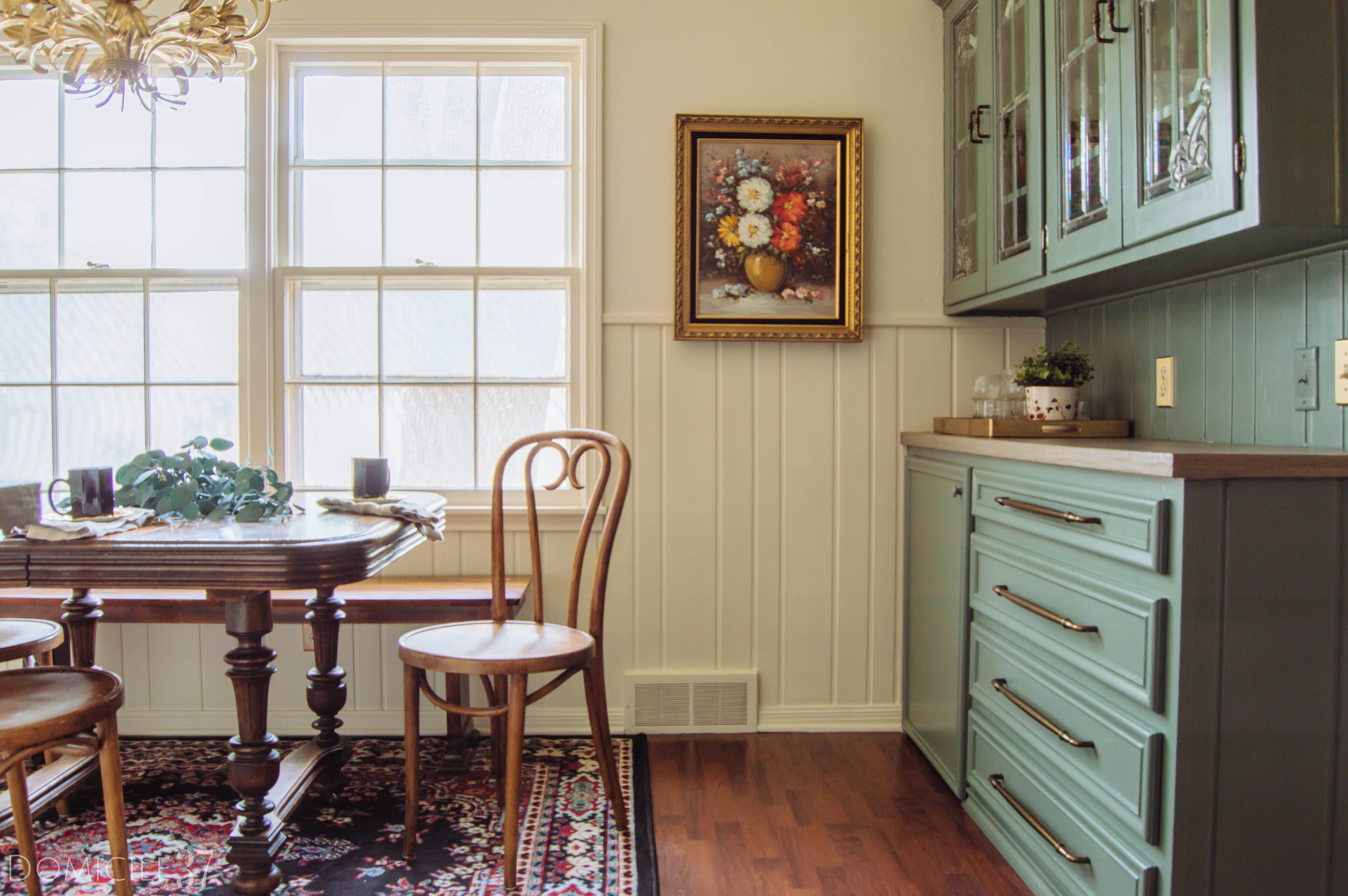 One Room Challenge, European Inspired Breakfast Area, Dining Room Makeover, Vintage Wood Table, Farrow and Ball, Thomas Mach, Clay subway tile, Creame cabinets white subway tile, Farrow and Ball Clunch Paint, simple decor styling, italian toleware chandelier, persian rug dining room, DIY gold leaf light fixture, vintage oil painting, green kitchen cabinets