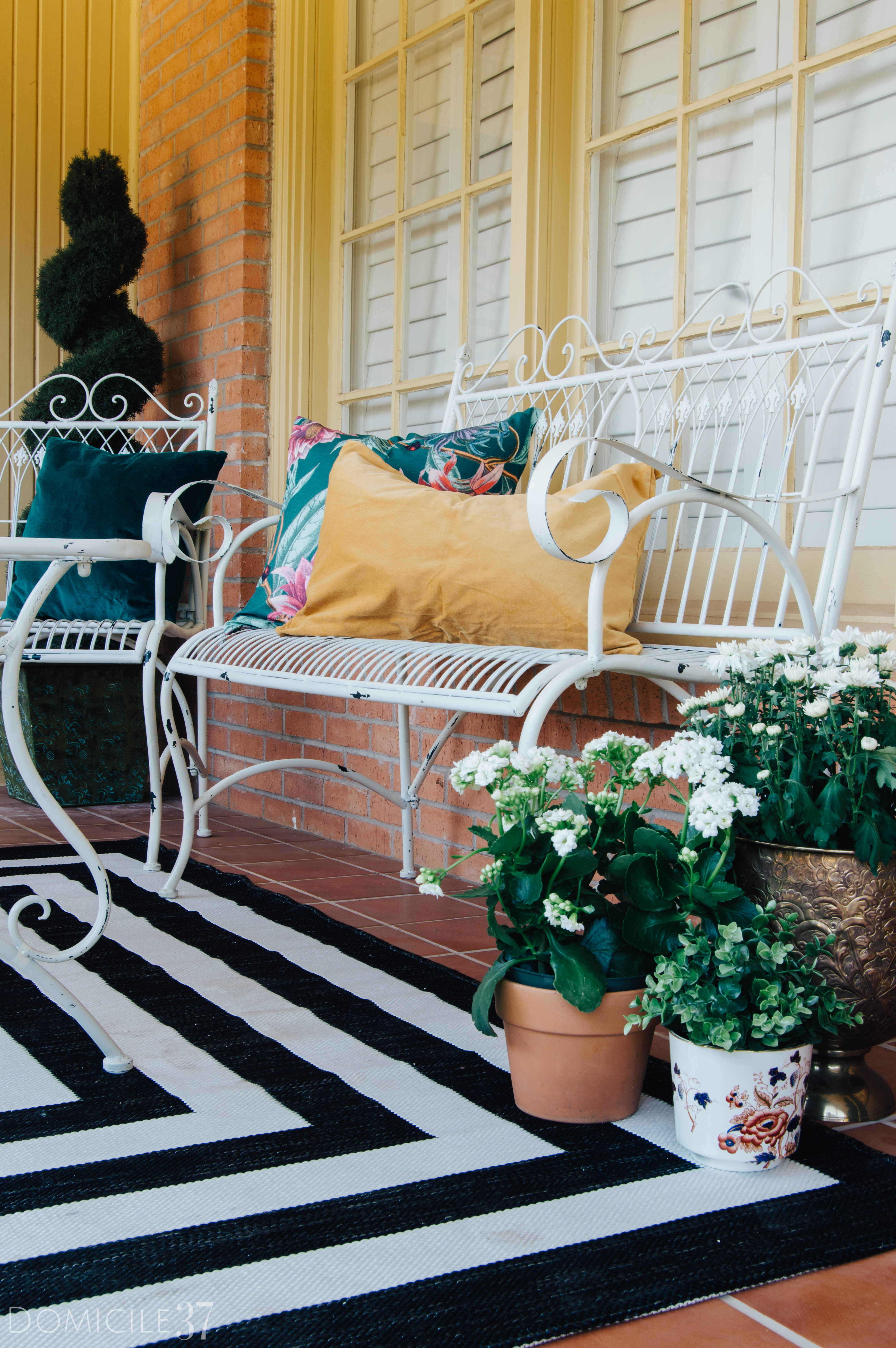 Brass planters, eclectic outdoor furniture setting, vintage outdoor furniture
