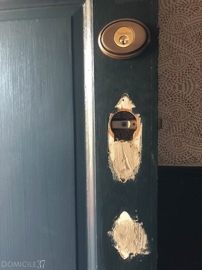 Using wood putty to patch door hole, antique door