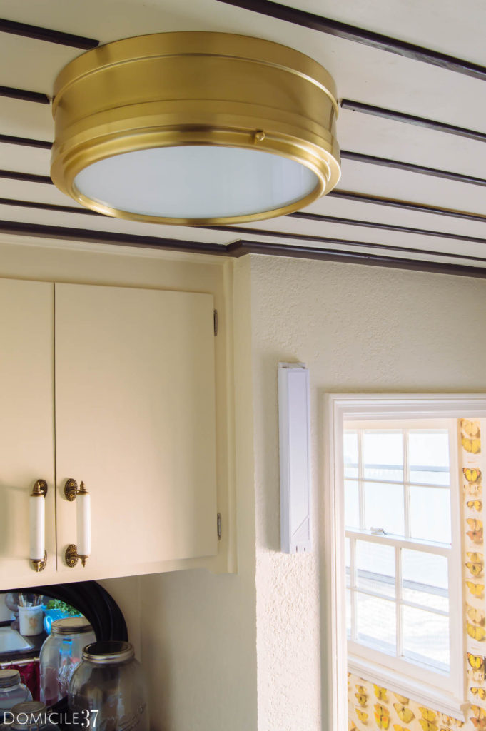 Brass light fixture, laundry room lighting, striped ceiling, black and white ceiling