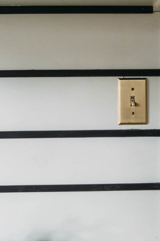 Shiplap backsplash, black and white shiplap, brass  outlet covers, Black and white stripes