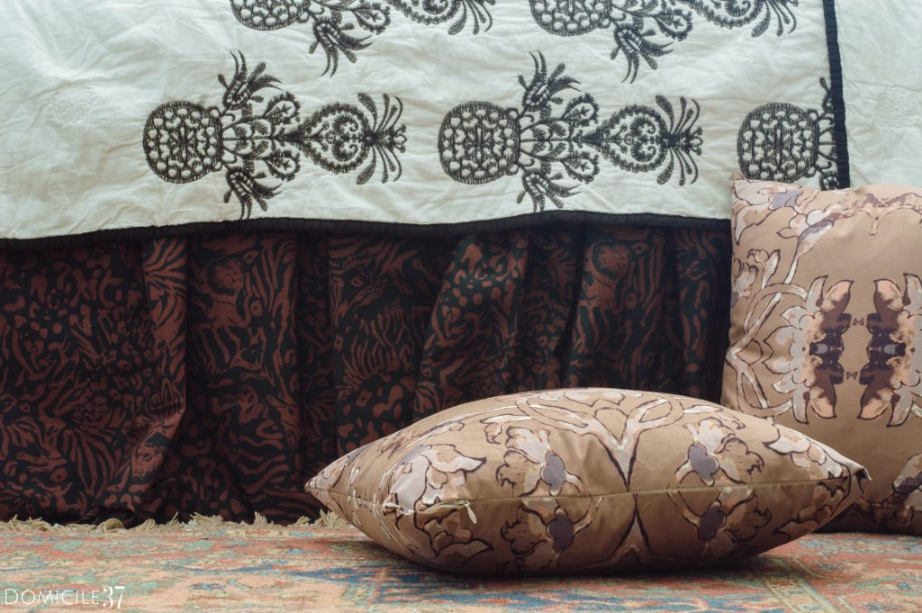 Smith Honig camouflaged jagger fabric made into ruffled bedskirt with Obi Rose taupe colored throw pillows