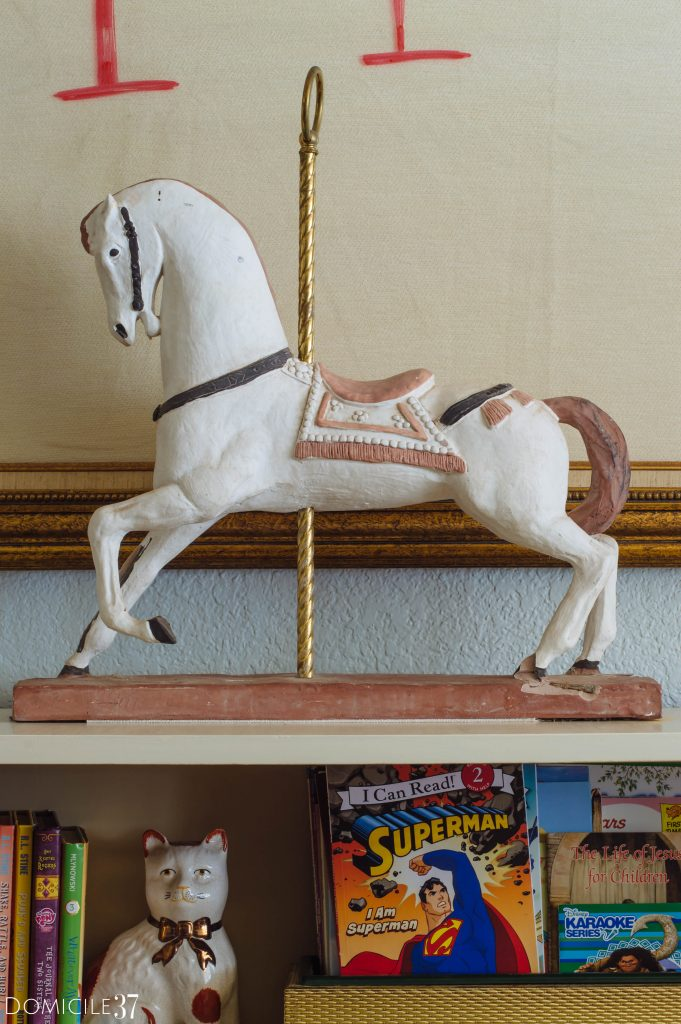 vintage carousel horse sitting on a shelf