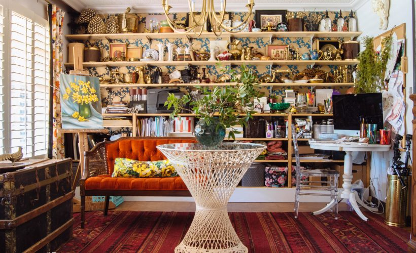 Workspace for a creative shop owner accented with floral silhouette wallpaper