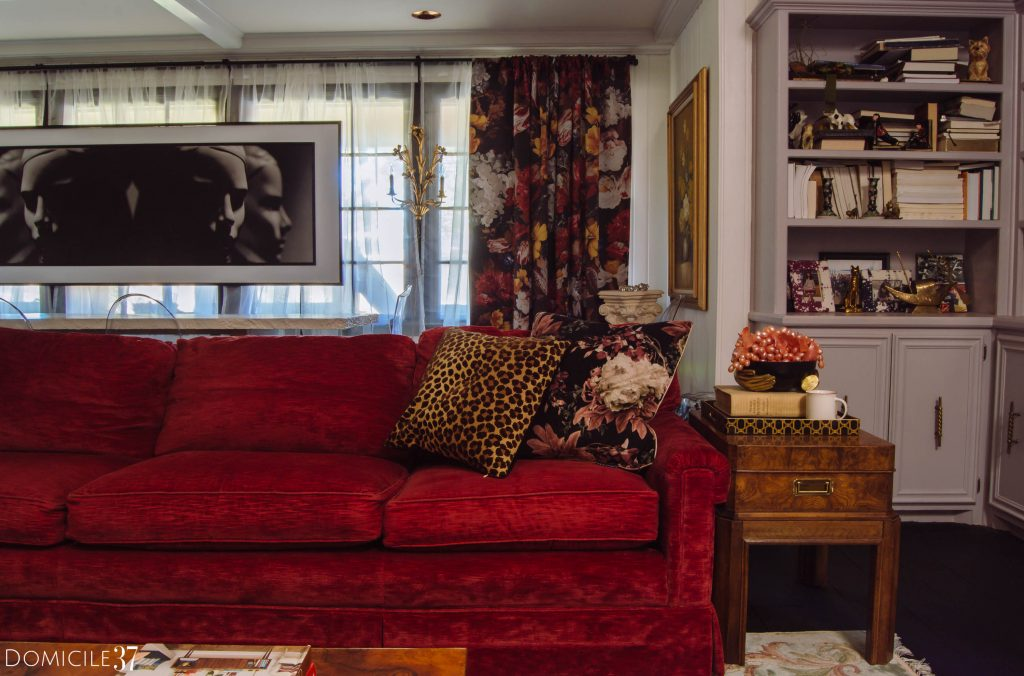 Red sofa in maximalist, eclectic, colorful living room