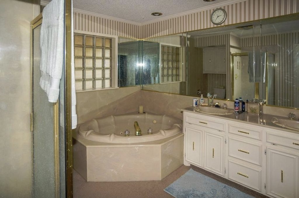 Before photo of bathroom renovated in late 80s early 90s with culture marble tub.