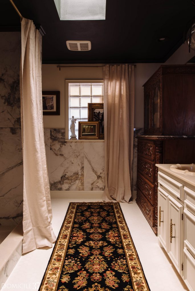 French Gothic Inspired Bathroom with porcelain marble walls and a warm sultry vibe