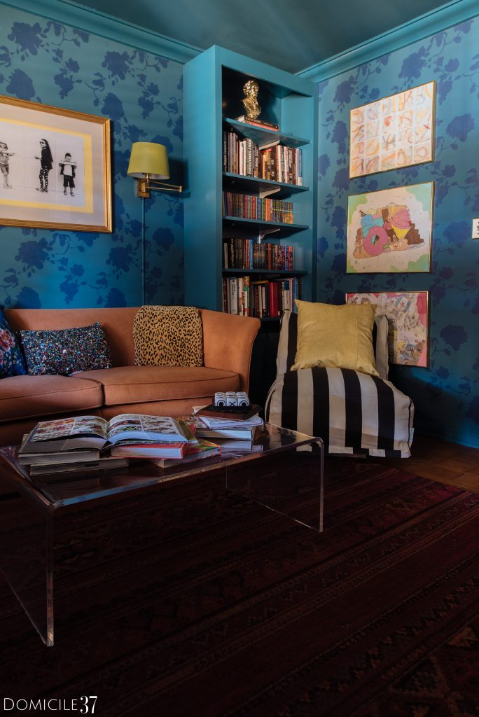 Tone on tone room with floral stenciled walls and kids art