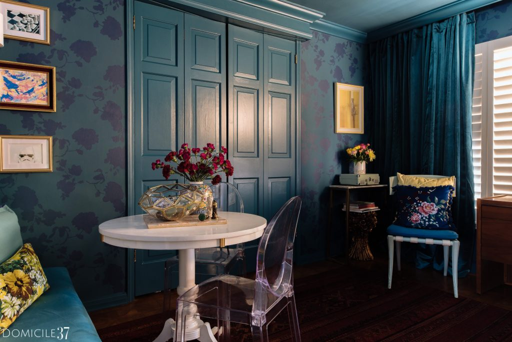 Tone on tone room with floral stenciled walls with game table and lucite chairs